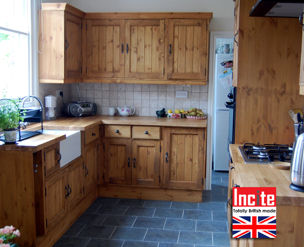 Corner view of the rustic pine kitchen with tongue and groove panelled