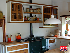 Rustic Country Painted Fitted Kitchen Showing Breakfast Bar and The Unique Dowelled Detail To The Wall Unit Doors