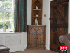Plank Pine Gothic Themed Corner cabinet with Arched Doors and open shelves