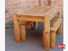 Custom made Junk leg on this table is positioned on the outer edges leaving flexibilty for additional seating